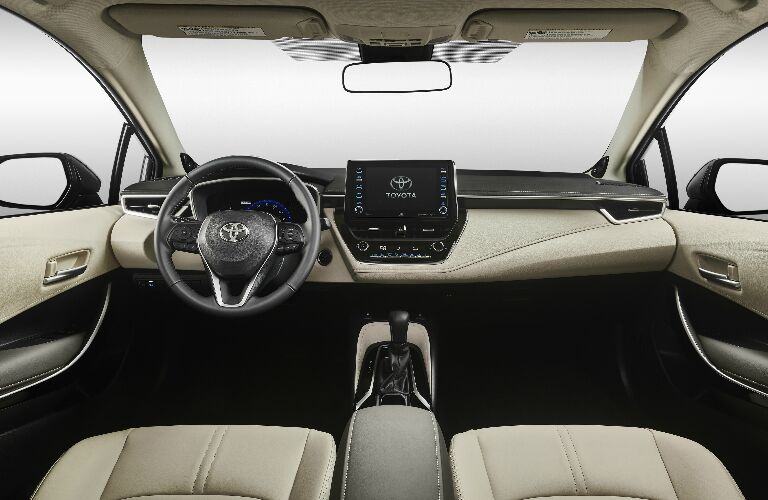 Dashboard and white front seats in 2020 Toyota Corolla