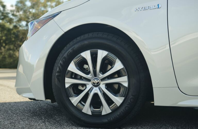 Wheel and Hybrid badge on white 2020 Toyota Corolla Hybrid