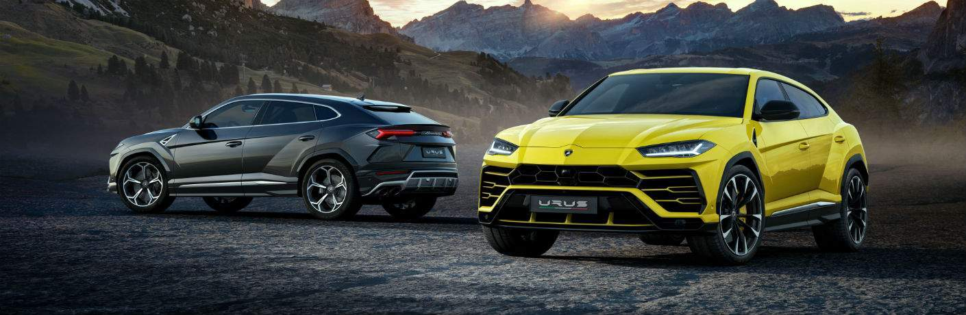 2018 Lamborghini Urus SSUV Exterior Driver Side Front and Rear Two Models