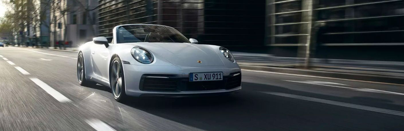 2020 Porsche 911 Carrera 4 Cabriolet Exterior Passenger Side Front Angle with Top Down