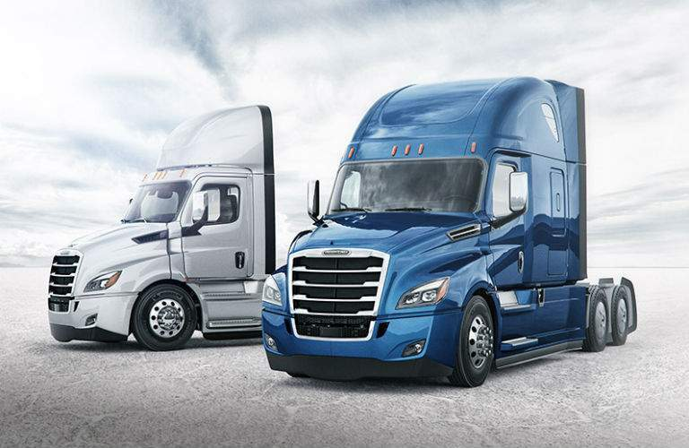 Two Freightliner Cascadia Models Exterior Driver Side Front