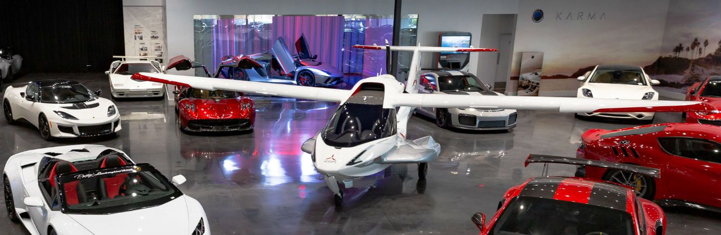 ICON A5 Aircraft Surrounded by Exotic Cars