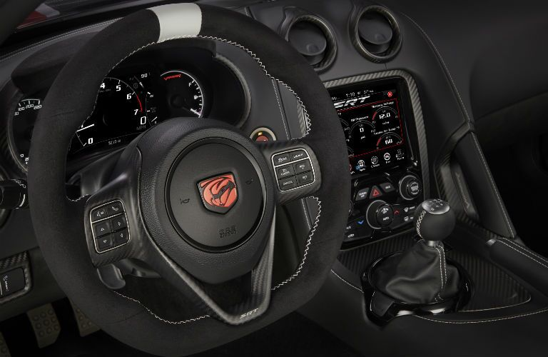 A photo of the driver's cockpit in a used Dodge Viper.