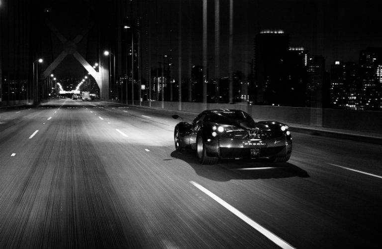 Pagani Model Driving Away at Night