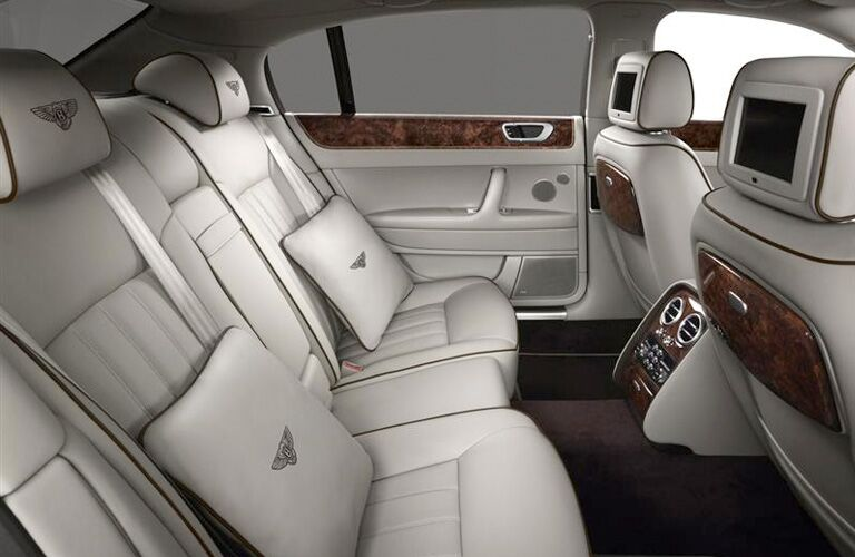 rear seats with pillows in a bentley continental