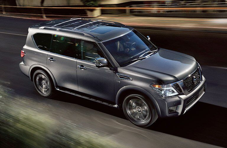 2017 Nissan Armada exterior front side on nighttime road