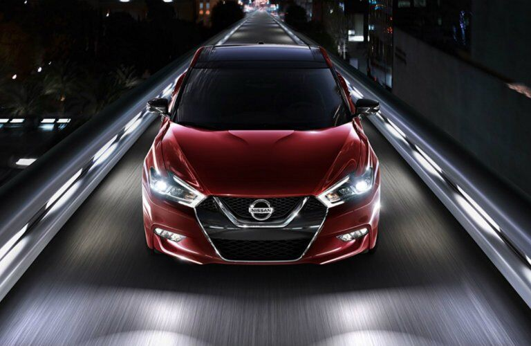 red 2017 Nissan Maxima exterior front driving down highway