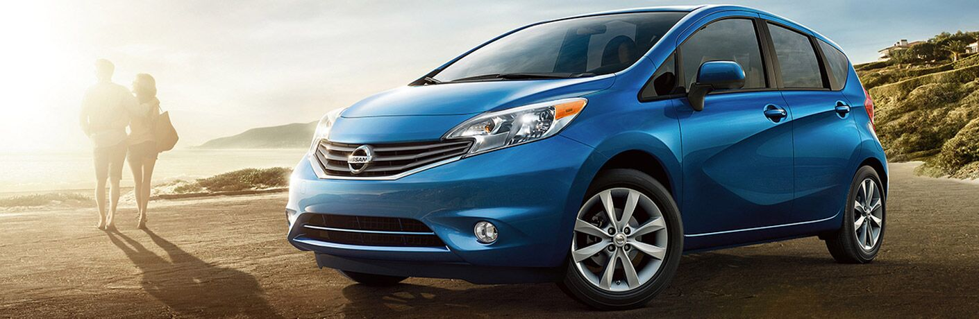 blue 2017 Nissan Versa Note parked on beach