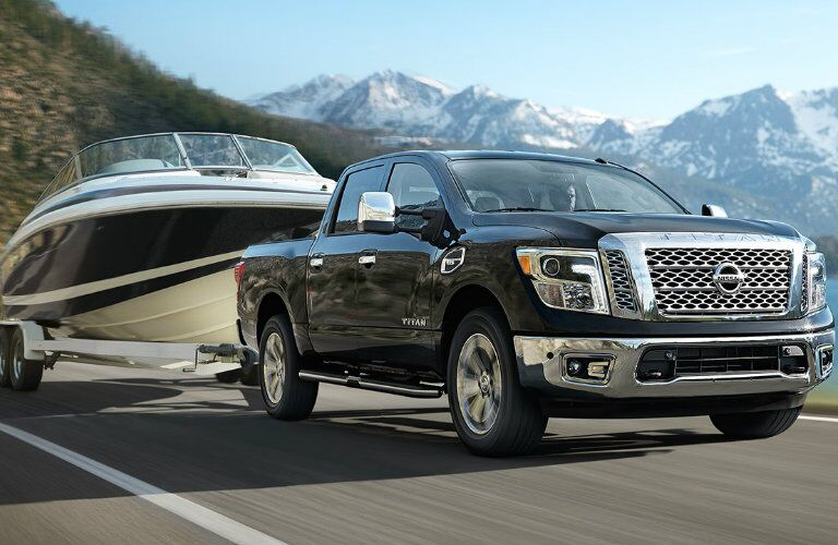 blue 2017 Nissan Titan towing a boat