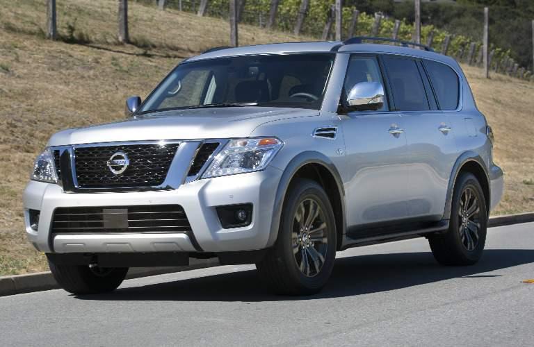 silver 2017 Nissan Armada driving down street