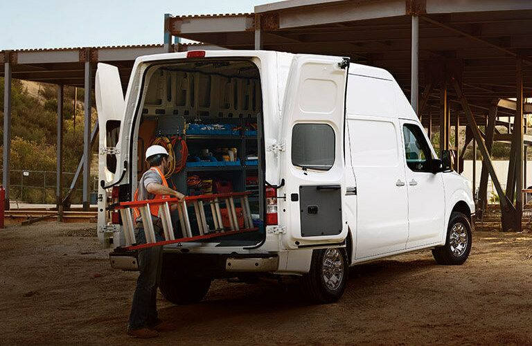 man loading ladder into 2017 Nissan NV Cargo