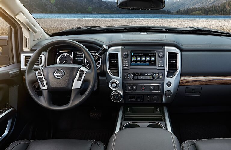 View of 2018 Nissan TITAN interior showing steering wheel and infotainment system