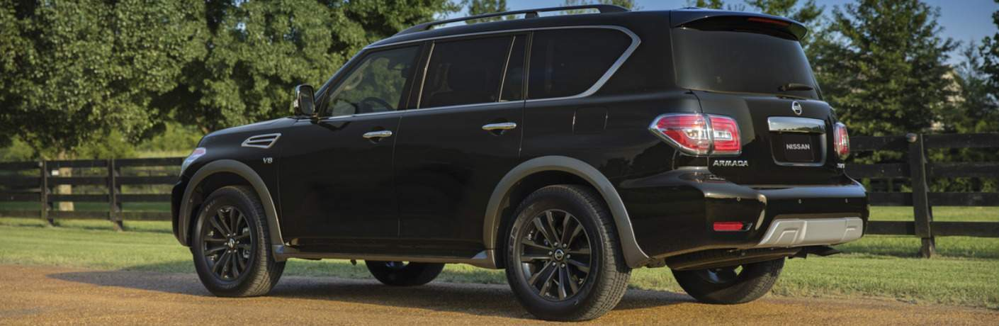 black 2018 Nissan Armada exterior rear driver side parked