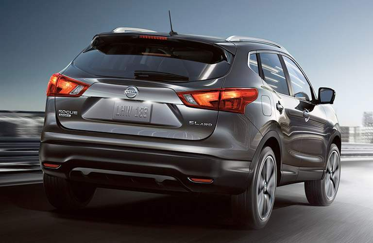 2017 Nissan Rogue Sport driving on highway rear view