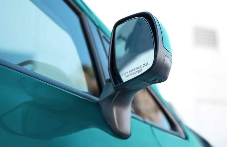 closeup of passenger side mirror on 2017 Nissan Versa Note