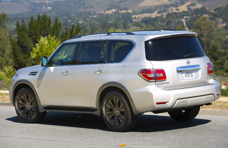 silver 2017 Nissan Armada side rear angle driving down the street
