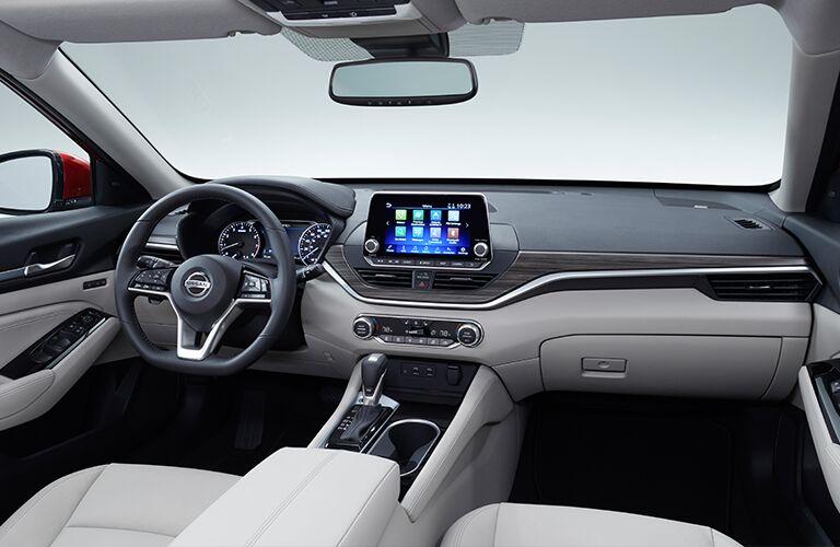2019 Nissan Altima interior front seating view of steering wheel, dashboard, transmission, and infotainment screen