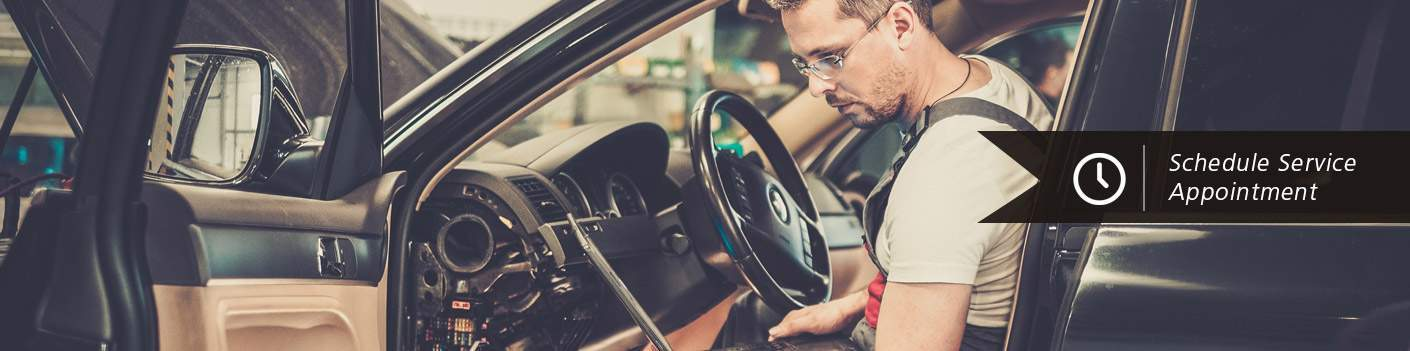 man working on vehicle electric system
