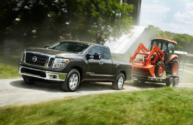gray 2018 Nissan Titan towing