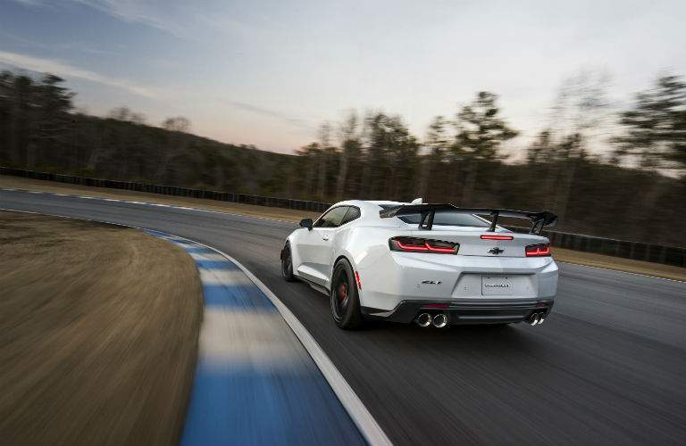 2018 Chevy Camaro driving away on race track