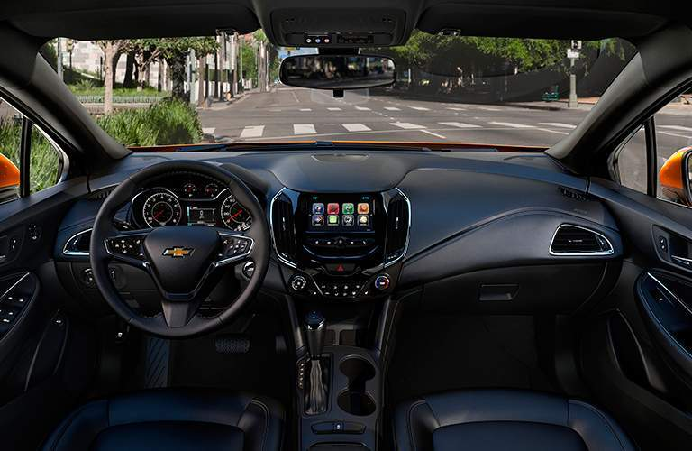 Dashboard of 2018 Chevrolet Cruze with steering wheel and touchscreen prominently shown