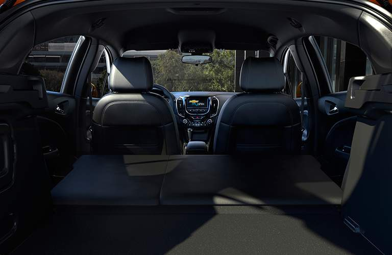 Rear seats folded in 2018 Chevrolet Cruze with front row and dashboard visible