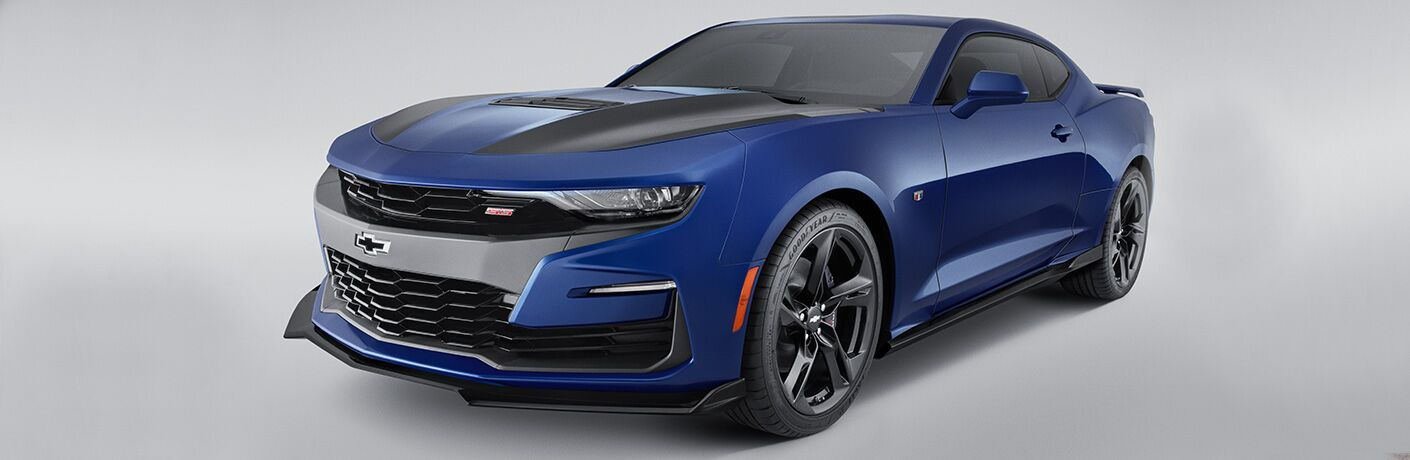 2019 Chevy Camaro exterior shot with blue paint color set in a blank white showroom