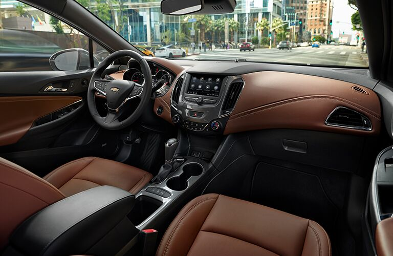 2019 Chevrolet Cruze interior shot of front seating, steering wheel, dashboard technology and accent trimming