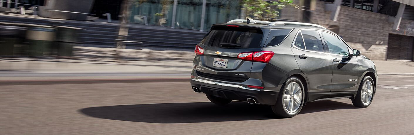 Pewter 2019 Chevrolet Equinox driving on city road