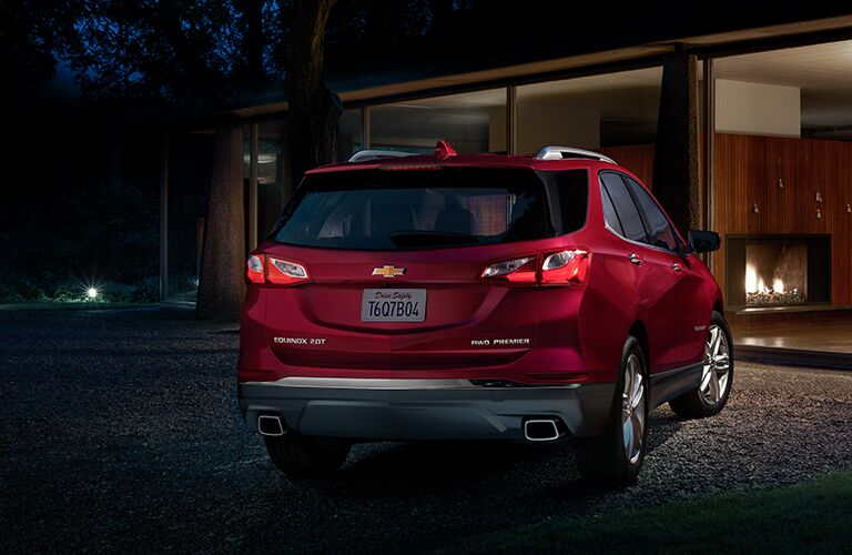 Rear shot of red 2019 Chevrolet Equinox parked in front of home
