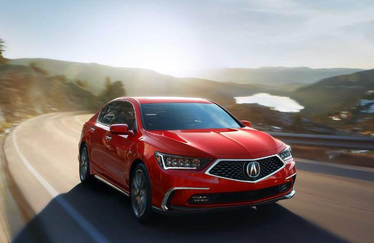 2018 Acura RLX Sport Hybrid in Brilliant Red Metallic driving in rural area