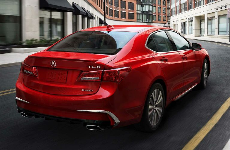 2018 Acura TLX in San Marino Red driving downtown