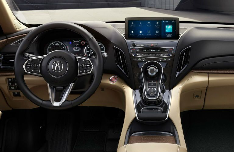 2019 Acura RDX with Advance Package and Parchment Interior with view of center console, infotainment center and steering wheel