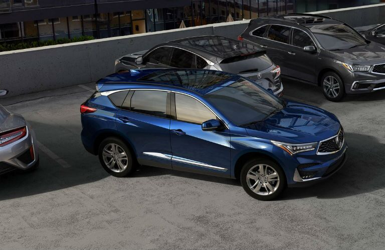 2019 Acura RDX with Advance Package in Fathom Blue Pearl backing into a parking space