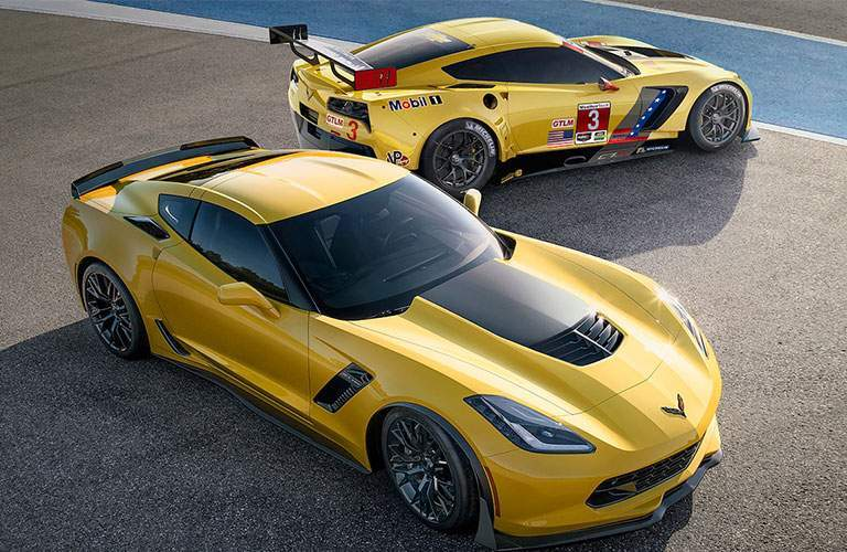 Two 2018 Chevy Corvette Z06 cars parked on racetrack