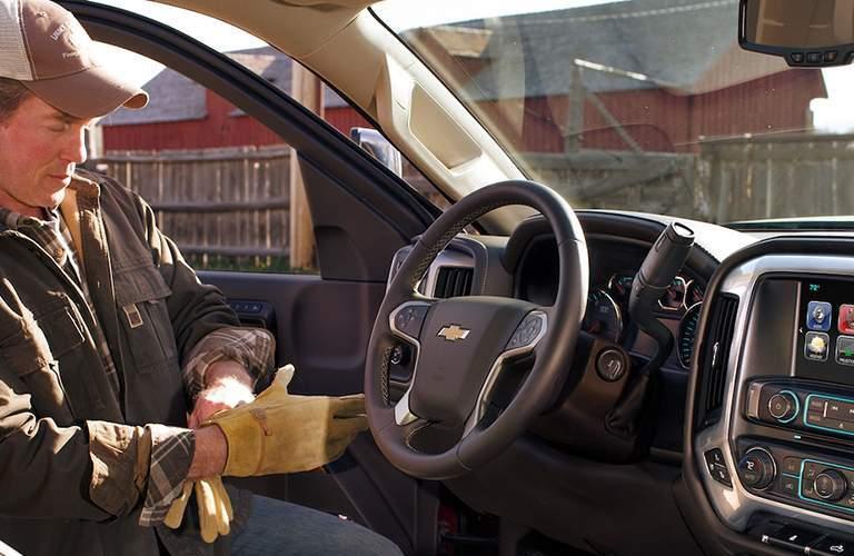 Man entering cab of 2018 Chevy Silverado 3500HD