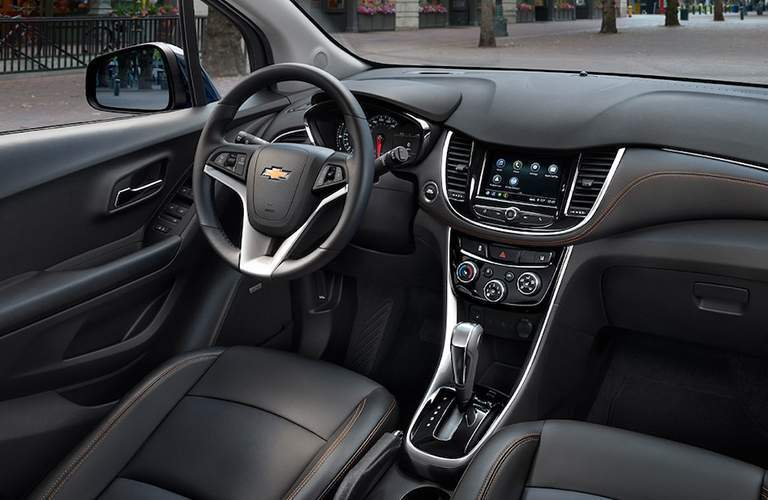Interior of the 2018 Chevrolet Trax with focus on the center console and the steering wheel