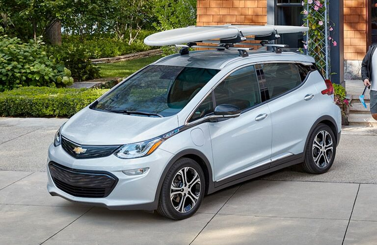 2018 Chevy Bolt EV parked with surf board on top of roof