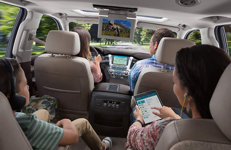 2018 Chevy Suburban interior view of seating area and rear-entertainment system