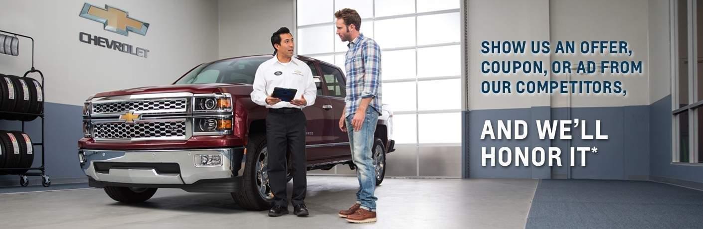 Mechanic talking to customer in garage
