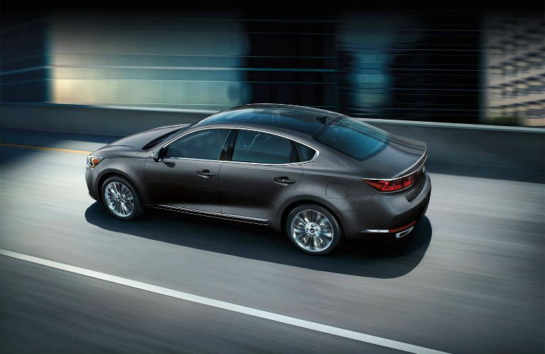 Exterior view of a gray 2019 Kia Cadenza driving down the highway