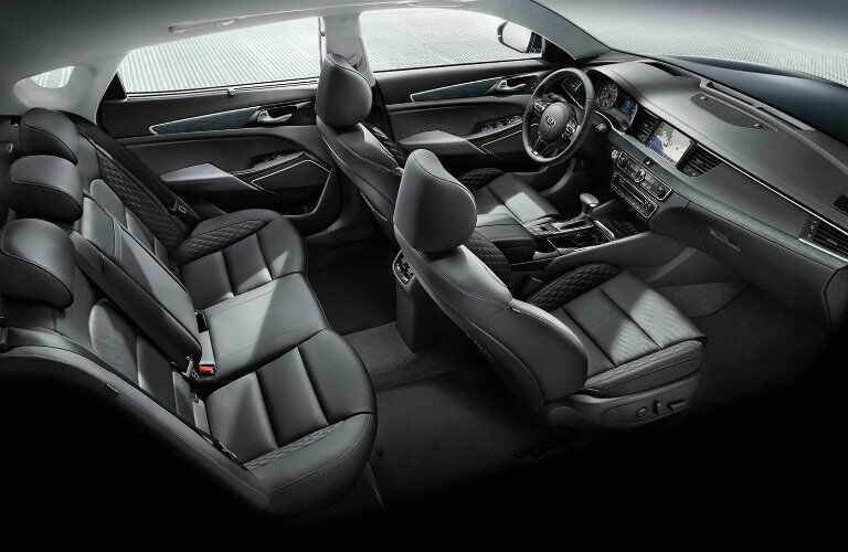 Interior view of the black seating and steering wheel inside a 2019 Kia Cadenza