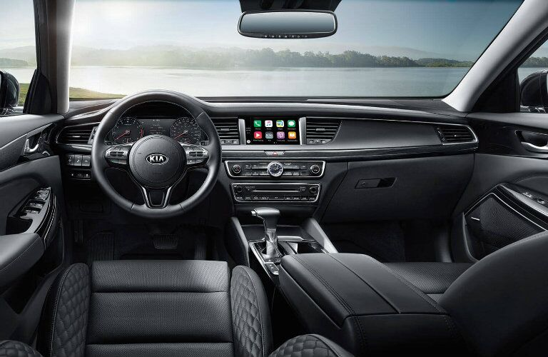 Interior view of the steering wheel and touchscreen infotainment system inside a 2019 Kia Cadenza