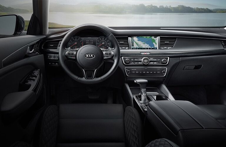 Interior view of the steering wheel and touchscreen inside the 2019 Kia Cadenza