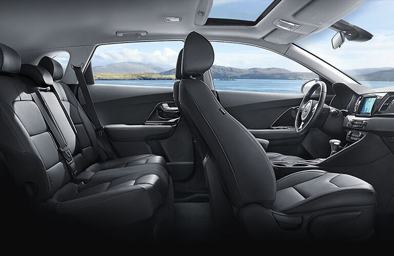 Interior view of the two rows of black seating inside a 2019 Kia Niro