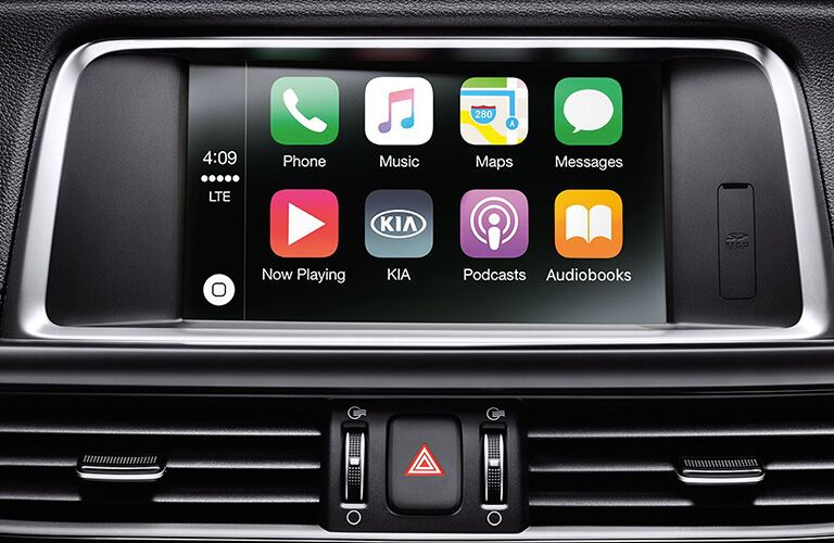 Closeup interior view of the touchscreen highlighting Apple CarPlay™ inside a 2019 Kia Optima