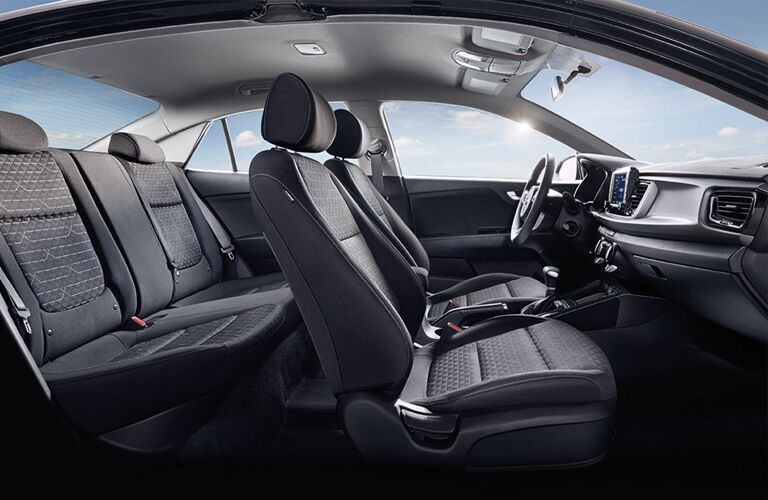 Interior view of the black seating inside of a 2019 Kia Rio