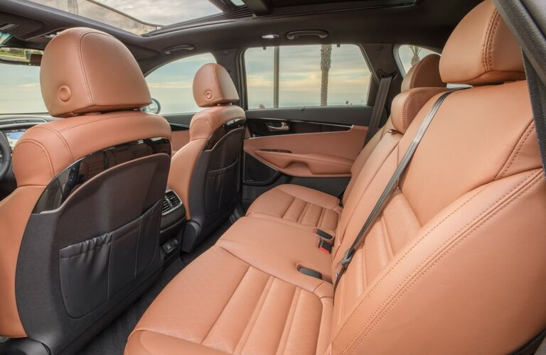 Interior view of the brown leather seating inside of a 2019 Kia Sorento