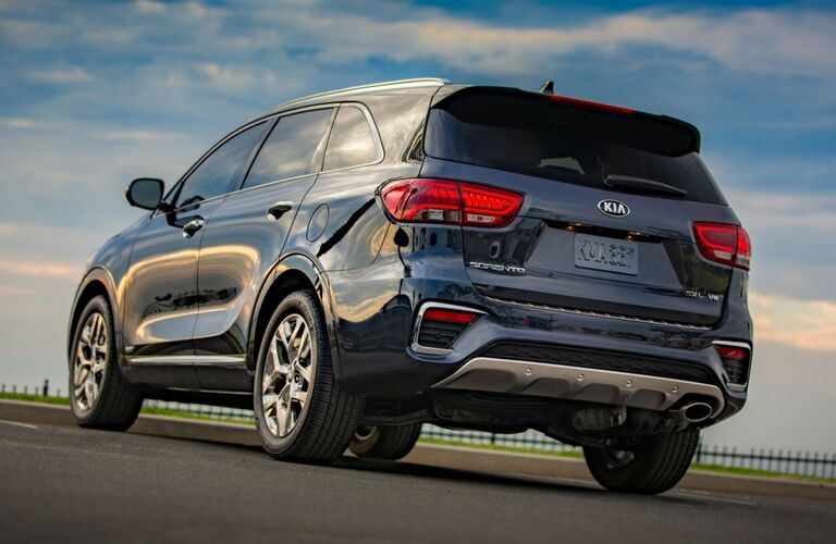 Exterior view of the rear of a blue 2019 Kia Sorento parked in a parking lot