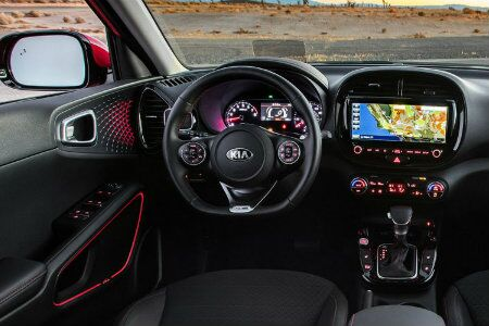 Interior of a 2020 Kia Soul showing steering wheel and navigation system
